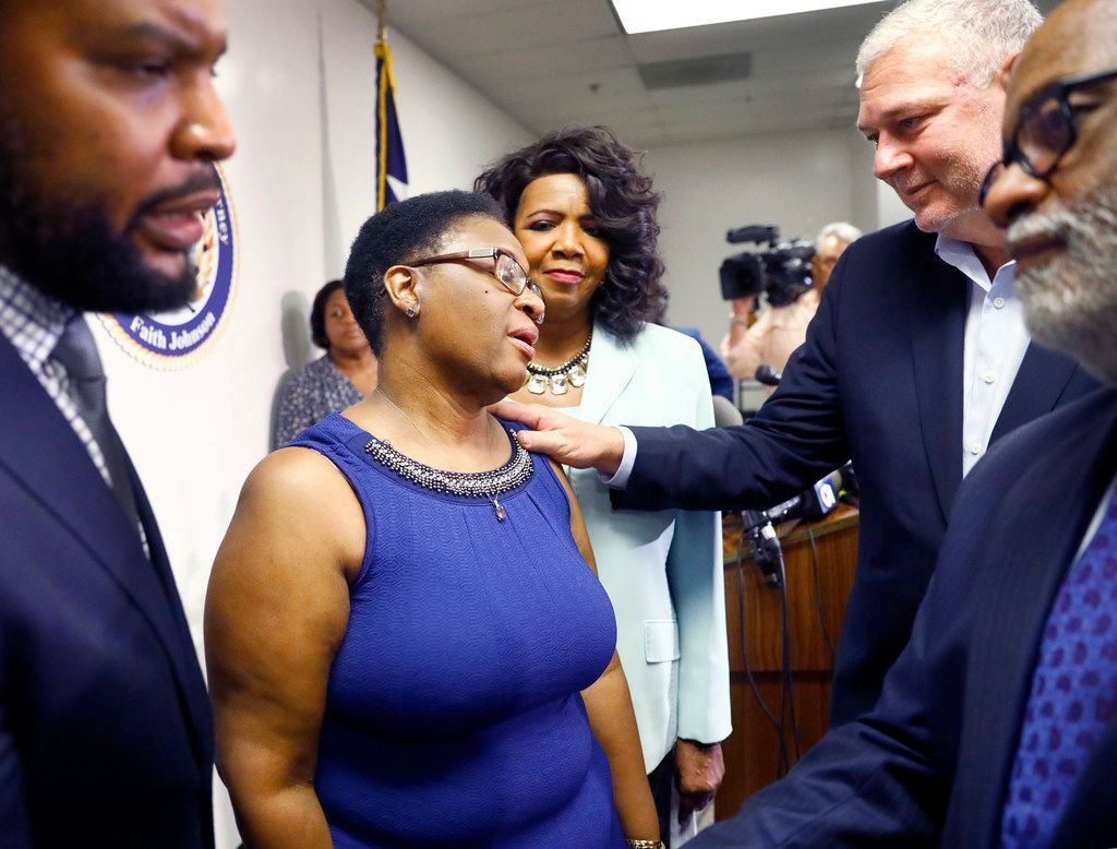Allison Jean (center, left), mother of shooting victim Botham Jean, accepts the condolences of Prime Minister of Saint Lucia Allen Chastanet (second from right) following a press conference by Dallas County District Attorney Faith Johnson.