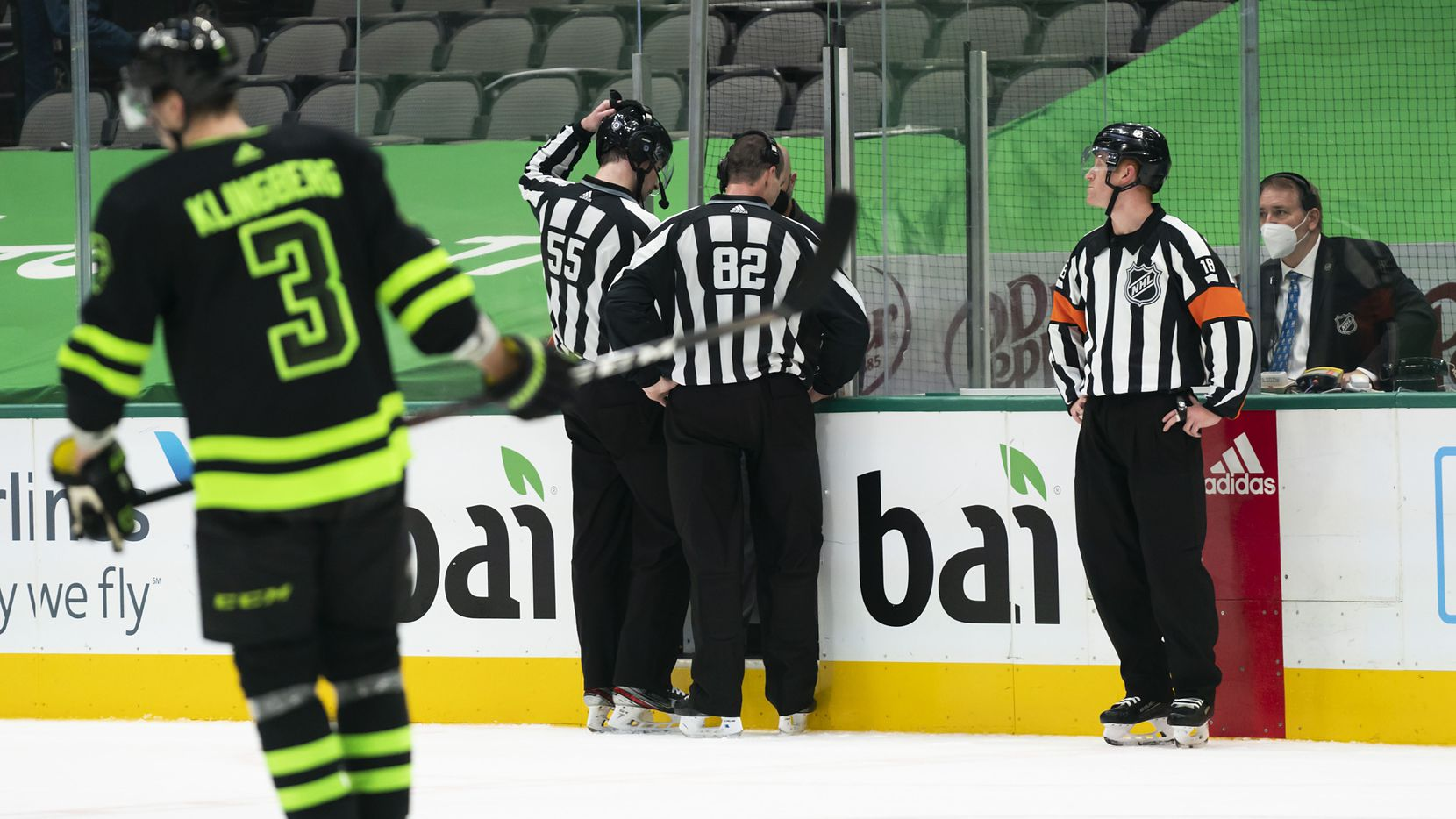 Officials review a goal by Florida Panthers defenseman Aaron Ekblad that was overturned on an offsides call during overtime of an NHL hockey game against the Dallas Stars at the American Airlines Center on Saturday, March 27, 2021, in Dallas.