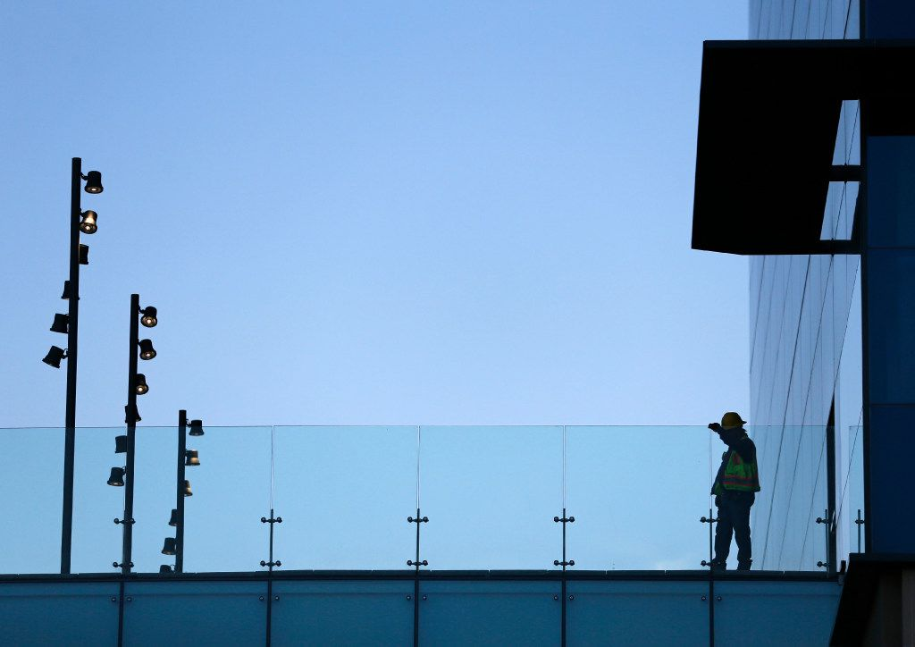 Construction worker above the main entrance at the new Toyota North American headquarters in Plano on Monday, May 15, 2017.