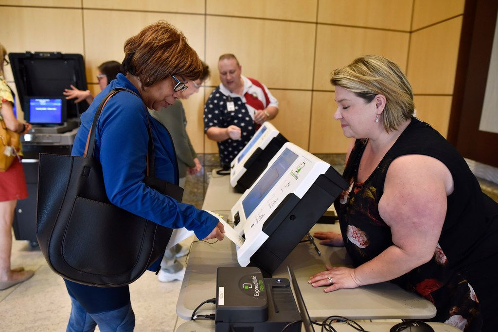 Constancia Shaw (left) uses the new Express Vote machine with help from Dallas County Election Day manager Tandi Smith during a demonstration of the new equipment for elections in September 2019 at Mesquite City Hall. Many area voters began using the machines in November 2019.