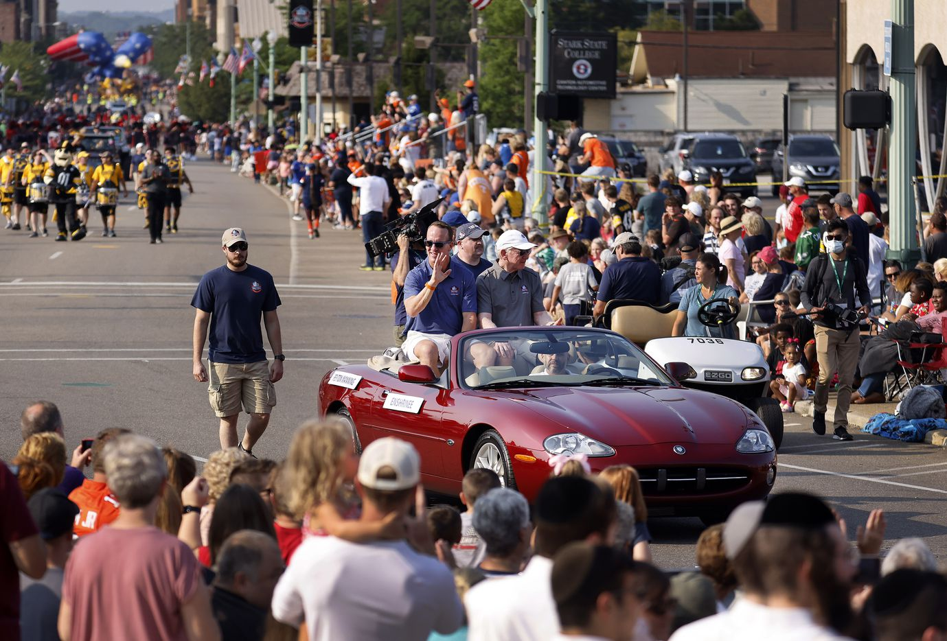 Indianapolis Colts quarterback and Pro Football Hall of Fame inductee Peyton Manning (in car, left) and his father Archie Manning wave to fans during the Canton Repository Grand Parade in downtown Canton, Ohio, Saturday, August 7, 2021. The parade honored newly elected and former members of the Hall. (Tom Fox/The Dallas Morning News)