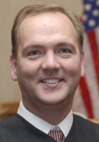 District Judge John Roach Jr. received a public admonition after a panel took issue with a website and referral service related to a divorce book he co-wrote with his wife, Laura Roach.