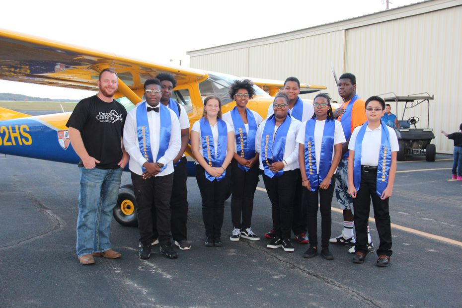 Lancaster students pose with the plane they built to fly humanitarian missions to impoverished countries.
