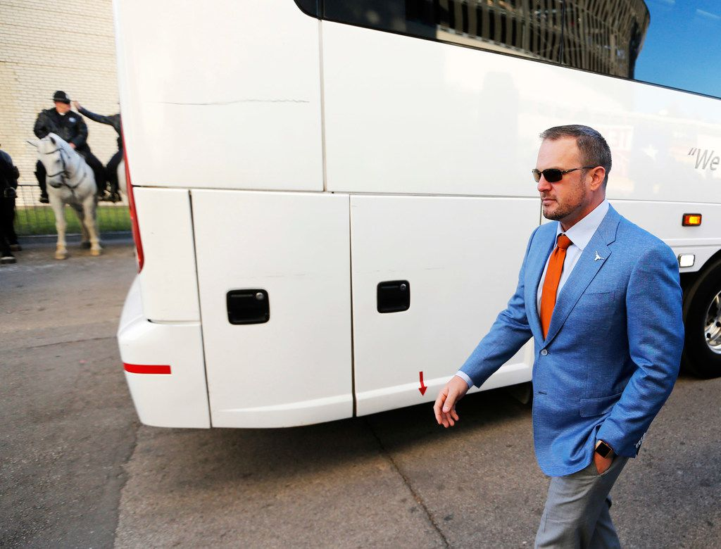 FILE - Texas head coach Tom Herman makes his way to the Cotton Bowl before the Red River Showdown against Oklahoma on Saturday, Oct. 12, 2019, in Dallas.