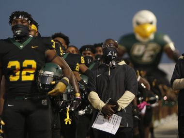 Shemar Turner (32) and the rest of the DeSoto Eagles pause for the playing of the national anthem prior to the opening kickoff against Trinity Christian Cedar Hill. The two teams played their non-district football game at Eagle Stadium in DeSoto on October 16, 2020.