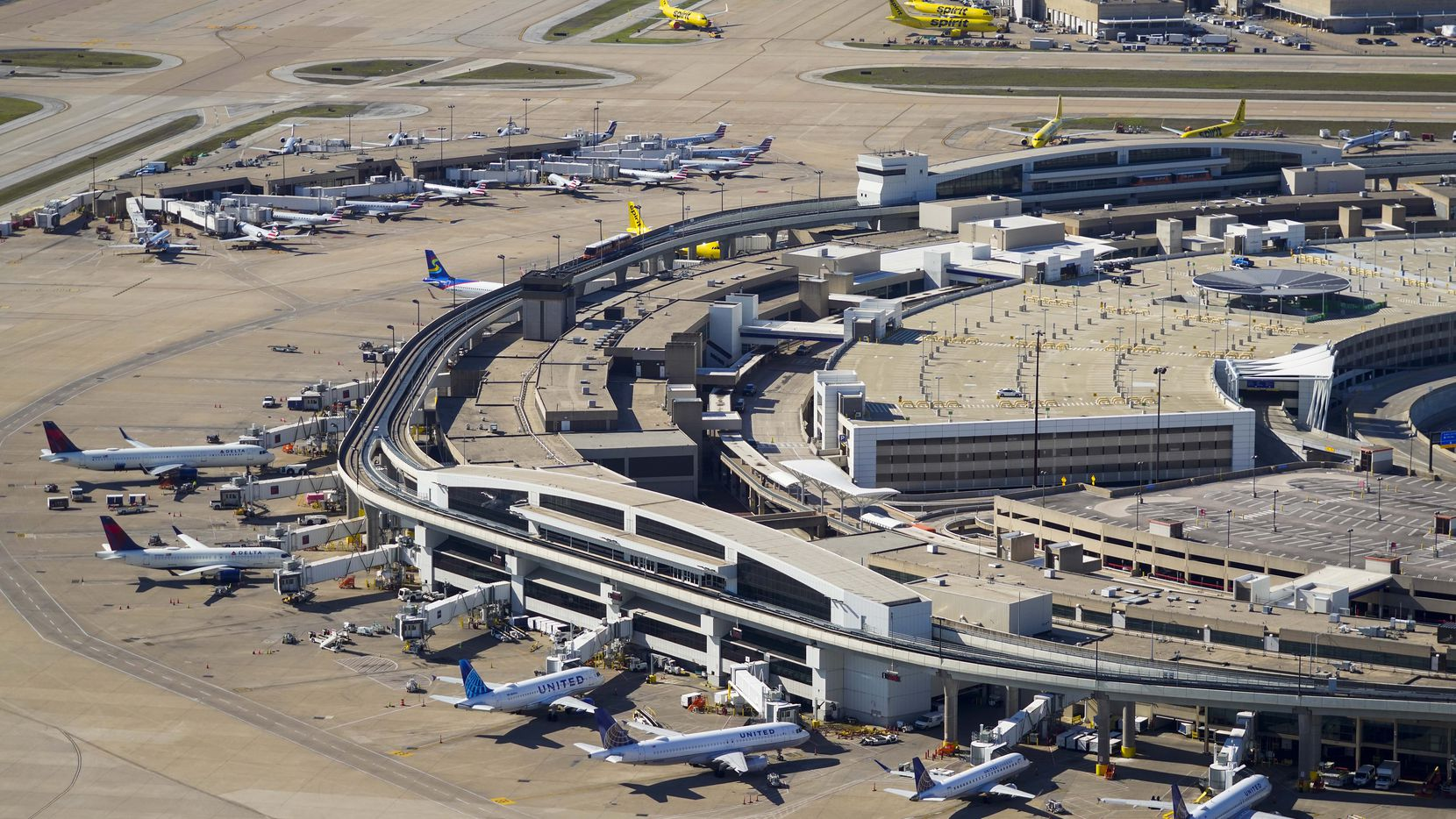 Aerial view of United, Delta and Spirit Airlines aircraft at the gates of Terminal E at Dallas Fort Worth (DFW) International Airport in April.