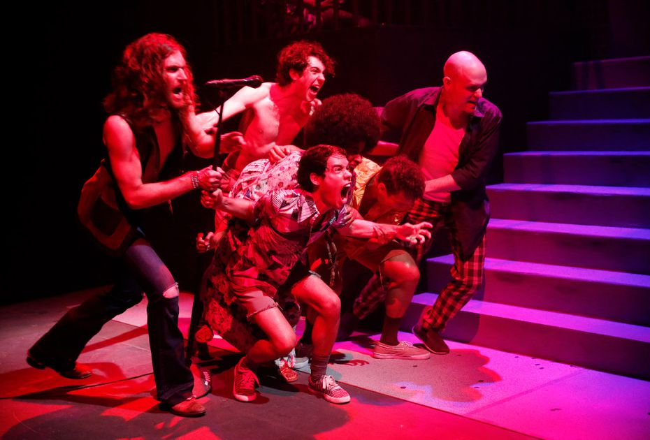 The cast of  Hit the Wall fights against a police raid in the regional premiere of the play about the Stonewall Riots at WaterTower Theatre in Addison.
