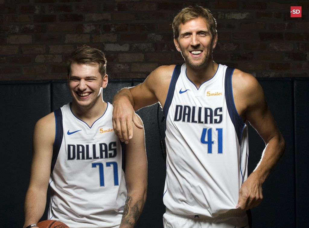 FILE - Mavericks players Luka Doncic (left) and Dirk Nowitzki poses for a photo during Mavericks Media Day at American Airlines Center in Dallas on Friday, Sept. 21, 2018.