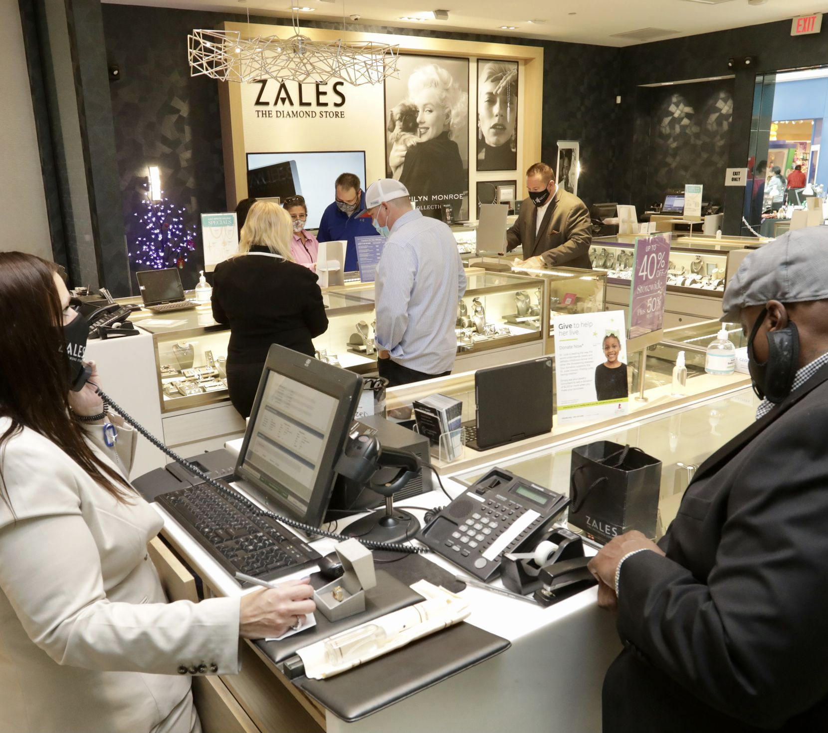 Customers browse the selection at the Stonebriar Centre Zales store in Frisco on Dec. 23.