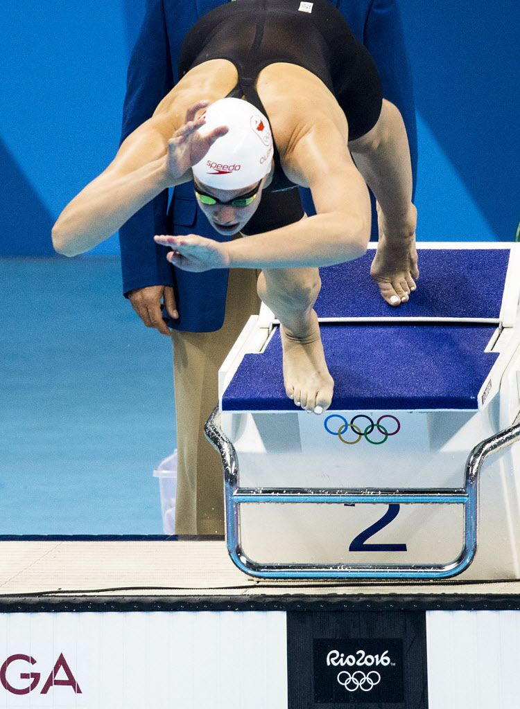 Penny Oleksiak of Canada dives into the start of the women's 100m butterfly finals at the Rio 2016 Olympic Games on Sunday, Aug. 7, 2016, in Rio de Janeiro. (Smiley N. Pool/The Dallas Morning News)