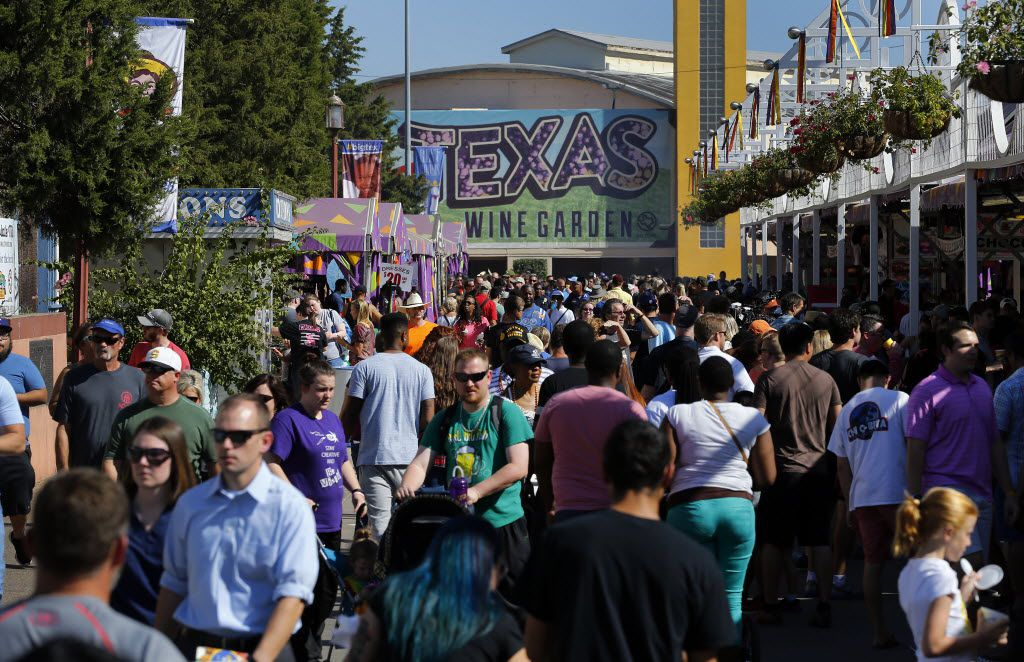 Fairgoers wander about Fair Park during the State Fair of Texas, Friday, October 16, 2015.