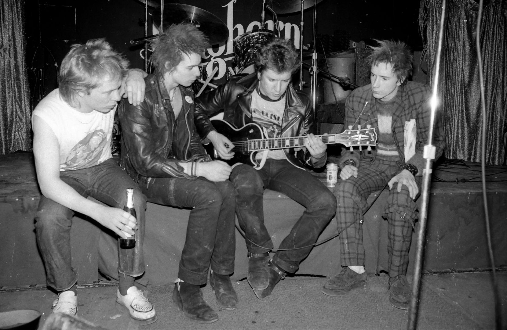 The Sex Pistols posed on stage at The Longhorn Ballroom, Dallas, during their final tour on January 10, 1978 L-R Paul Cook, Sid Vicious, Steve Jones, John Lydon (Johnny Rotten).