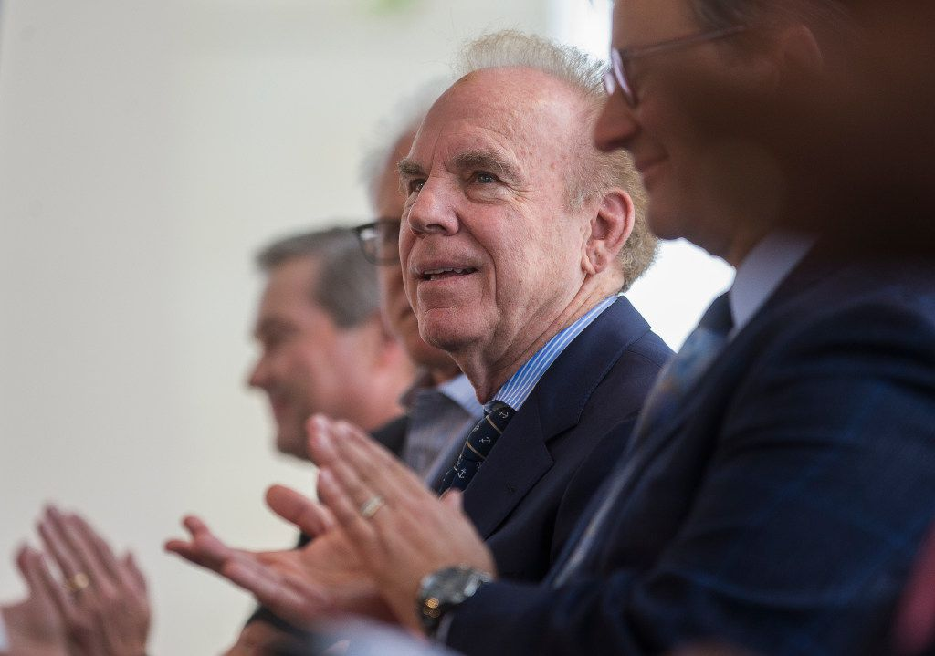 Roger Staubach listens to a speaker during a ribbon cutting ceremony at Legacy West in Plano, Texas on Friday, Jun 2, 2017. (Ryan Michalesko/The Dallas Morning News)