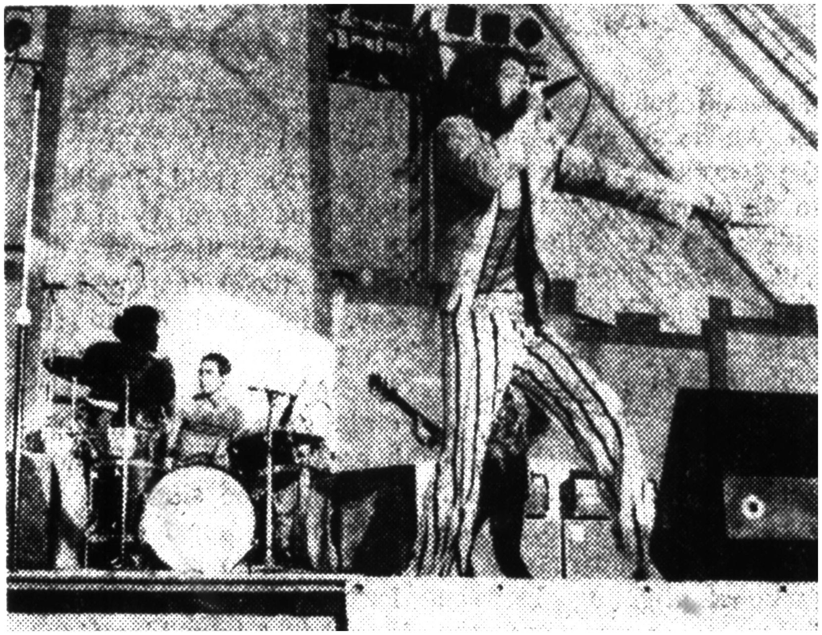 Mick Jagger and Charlie Watts (drums) perform to a crowd of more than 50,000 fans during their July 6, 1975, concert at the Cotton Bowl in Dallas.