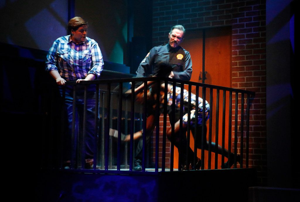 Gregory Lush (Cop) knocks Walter Lee (Carson) to the floor as Kelsey Leigh Ervi (Peg) watches in shock  in Hit the Wall.