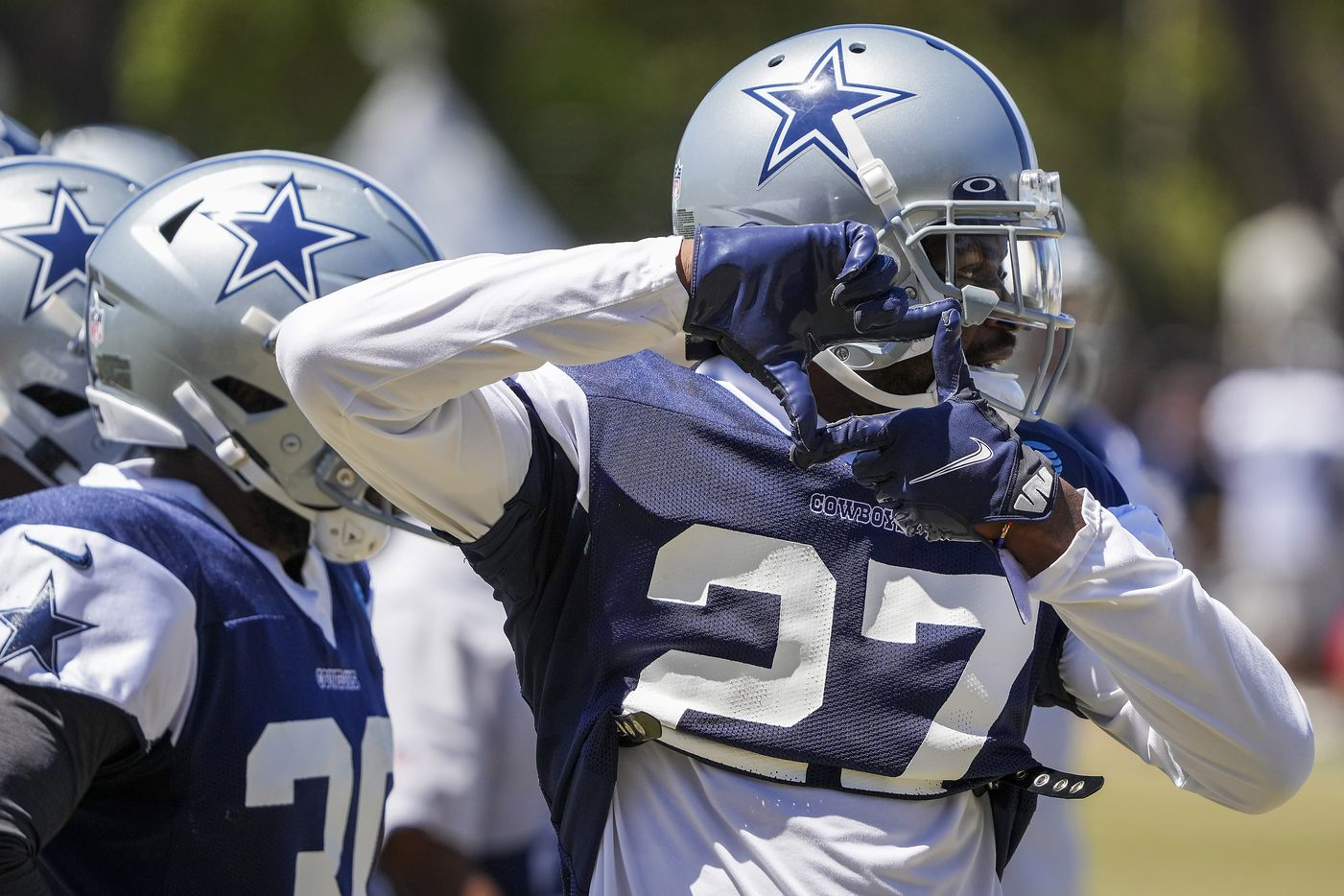 Dallas Cowboys cornerback Trevon Diggs (27) signals to teammates during a practice at training camp on Sunday, Aug. 1, 2021, in Oxnard, Calif.