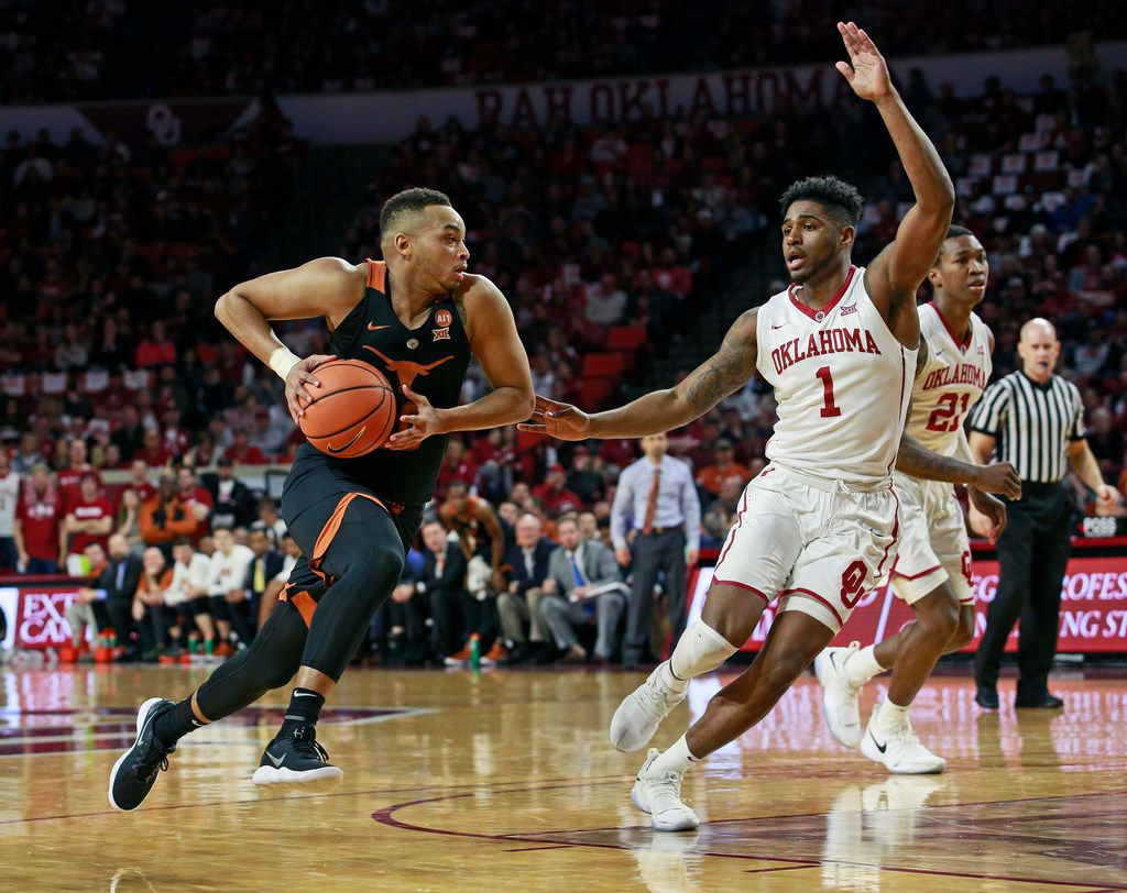 NORMAN, OK - FEBRUARY 17: Eric Davis Jr. #10 of the Texas Longhorns drives inside as Rashard Odomes #1 of the Oklahoma Sooners defends at Lloyd Noble Center on February 17, 2018 in Norman, Oklahoma. The Longhorns defeated the Sooners 77-66. (Photo by Brett Deering/Getty Images)