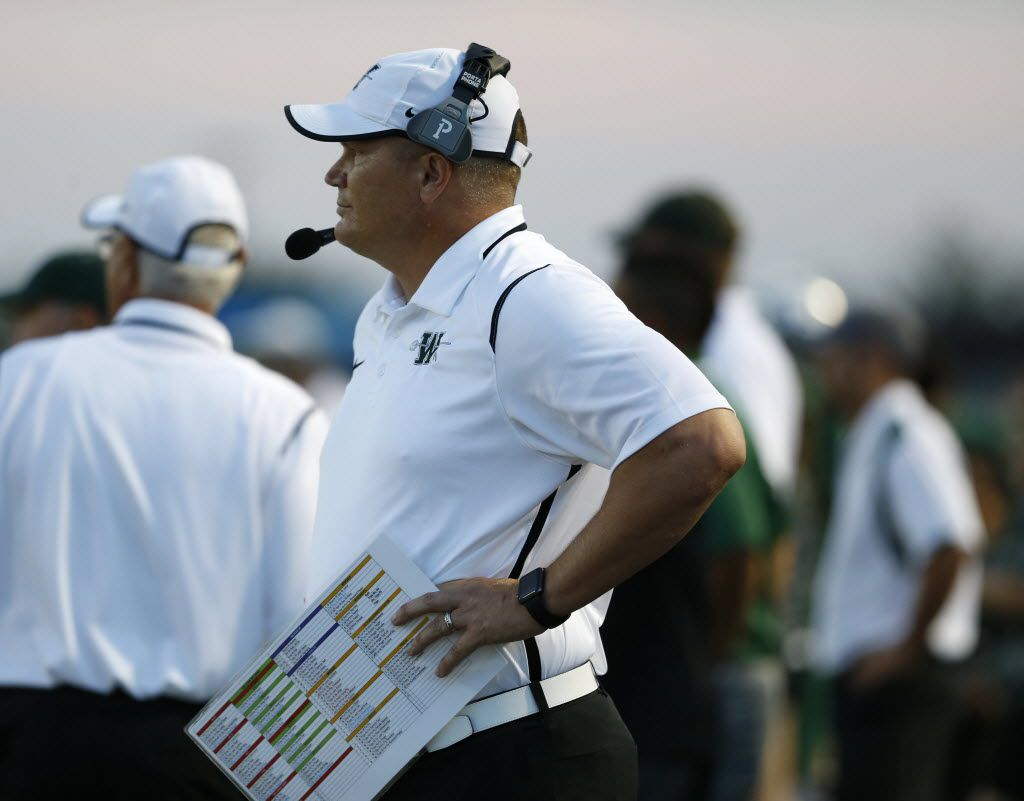 Waxahachie coach Jon Kitna watches the field in the first quarter of the game between Waxahachie High School and Ennis High School at Lumpkins Stadium in Waxahachie, Texas on Sept. 11, 2015. (Rose Baca/The Dallas Morning News)
