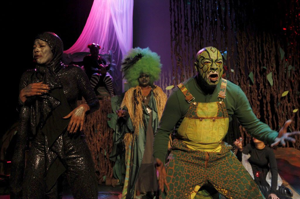 Booker T. Washington High School for the Performing and Visual Arts students designed the costumes of Rachael Webb (Sid the Snake), left, and Keith Price (Hostile Crocodile) in Soul Rep Theatre Company's original holiday show, A Hostile Holiday at the South Dallas Cultural Center.