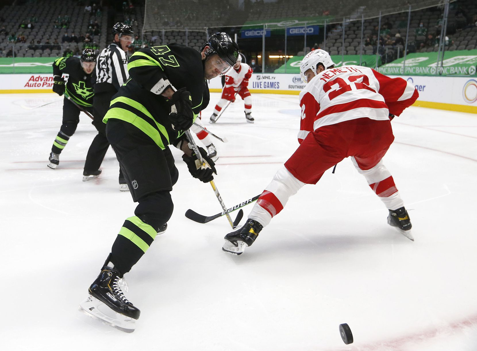 Dallas Stars right wing Alexander Radulov (47) rushes toward the puck as Detroit Red Wings defenseman Patrik Nemeth (22) looks back during the first period of play at American Airlines Center on Thursday, January 28, 2021in Dallas. (Vernon Bryant/The Dallas Morning News)
