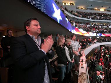 Dallas Stars owner Tom Gaglardi claps during the announcement of the Stars active military tribute prior to the start of Dallas Stars game against the Vancouver Canucks at the American Airlines Center in Dallas, Texas Sunday, February 26, 2015.