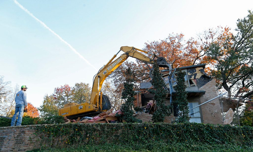 The house at 3756 Armstrong Ave., designed by noted modernist architect O'Neil Ford, was demolished Tuesday.