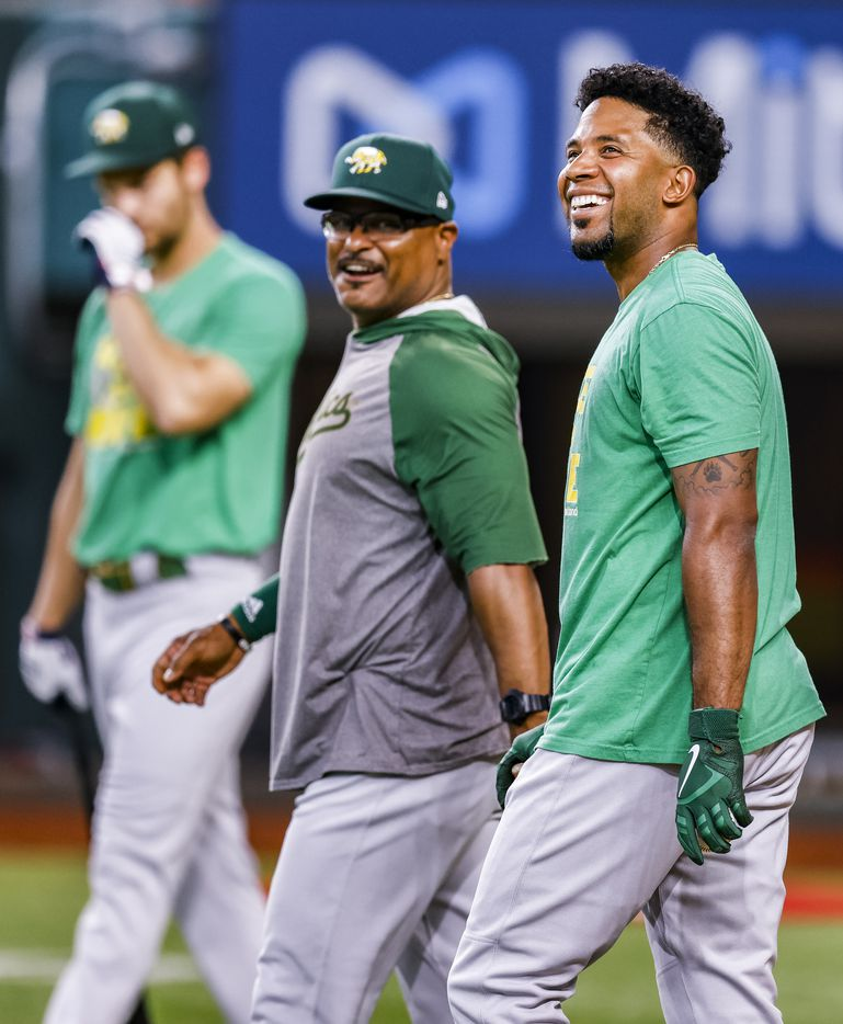 Oakland Athletics shortstop Elvis Andrus, right, looks on during batting practice before a game against Texas Rangers in Arlington, Monday, June 21, 2021. (Brandon Wade/Special Contributor)
