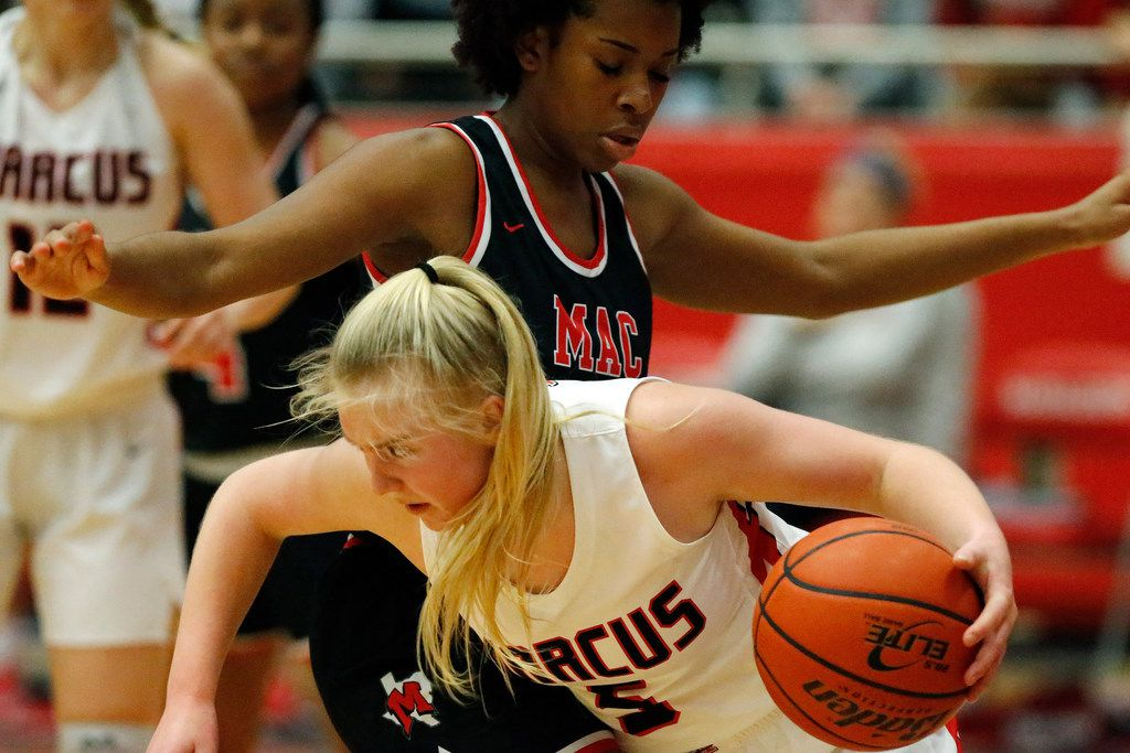 Flower Mound Marcus High School guard Abbie Barr (5) dribbles past Irving MacArthur High School forward Madison Green (32) during the first half as Flower Mound Marcus High School hosted Irving MacArthur High School in a girls basketball game in Flower Mound on Tuesday, January 14, 2020. (Stewart F. House/Special Contributor)