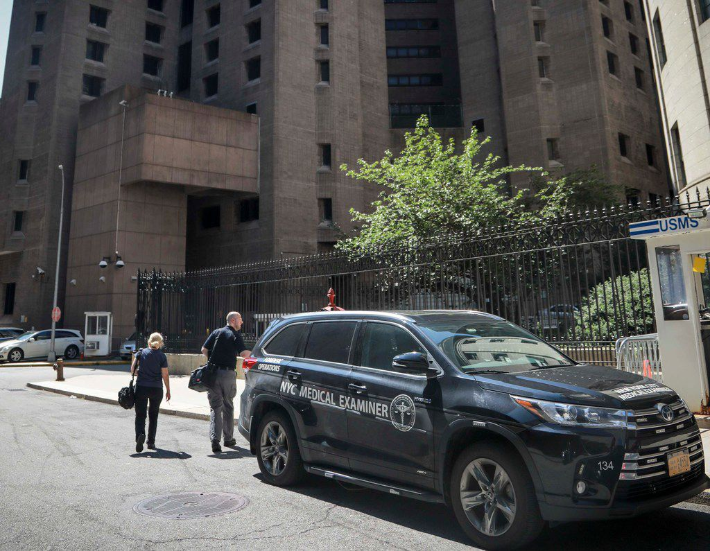 New York City medical examiner personnel leave their vehicle and walk to the Manhattan Correctional Center where financier Jeffrey Epstein died by suicide while awaiting trial on sex-trafficking charges, Saturday Aug. 10, 2019, in New York. He was found in his cell at the Manhattan Correctional Center Saturday morning, according to an official who was briefed on the matter but spoke on condition of anonymity because he wasn't authorized to discuss it publicly. The medical examiner's office in Manhattan confirmed Epstein's death.