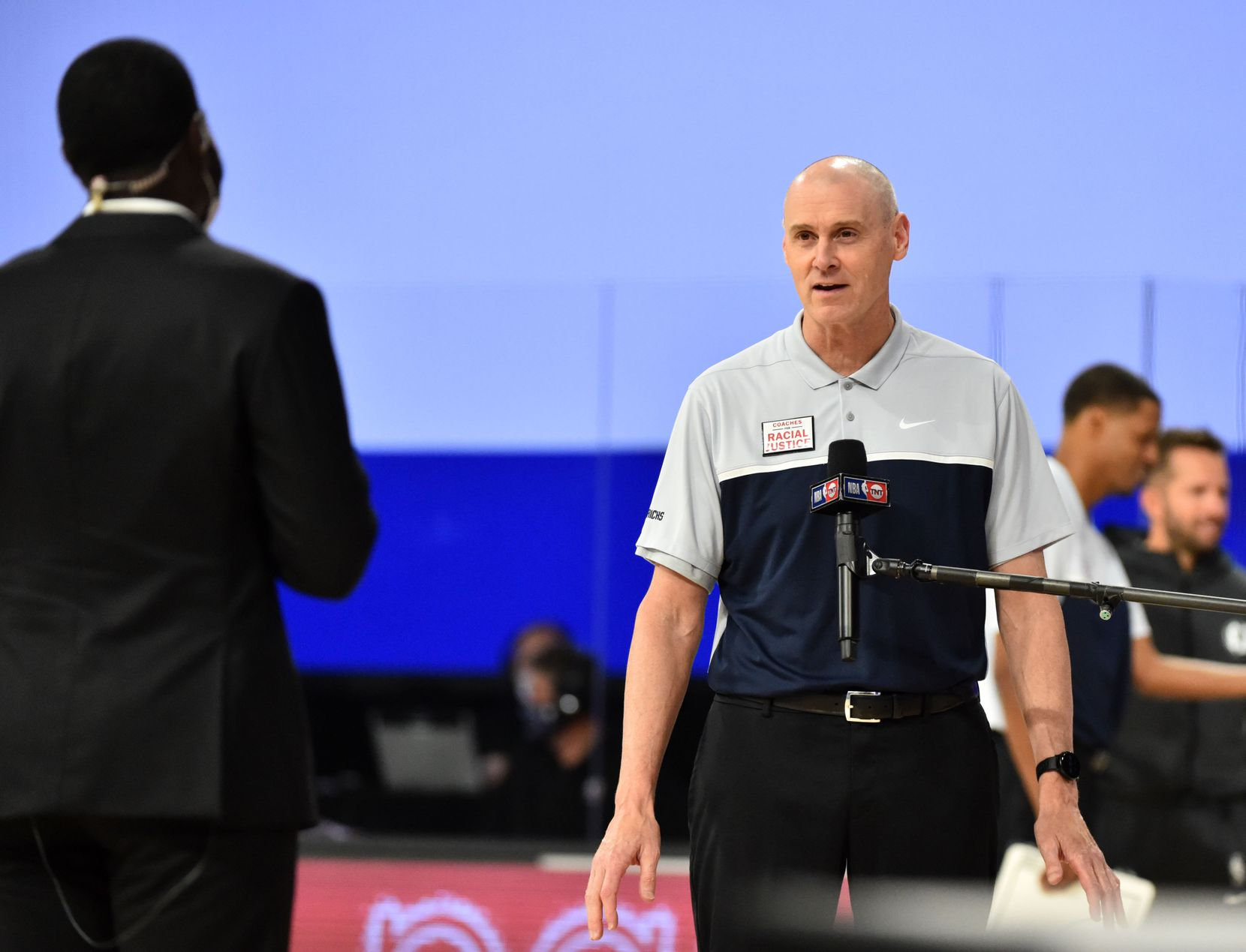 Orlando, FL - JULY 28: Mavericks head coach Rick Carlisle is interviewed during a scrimmage against the 76ers on July 28, 2020, at HP Field House at ESPN Wide World of Sports in Orlando, Fla.