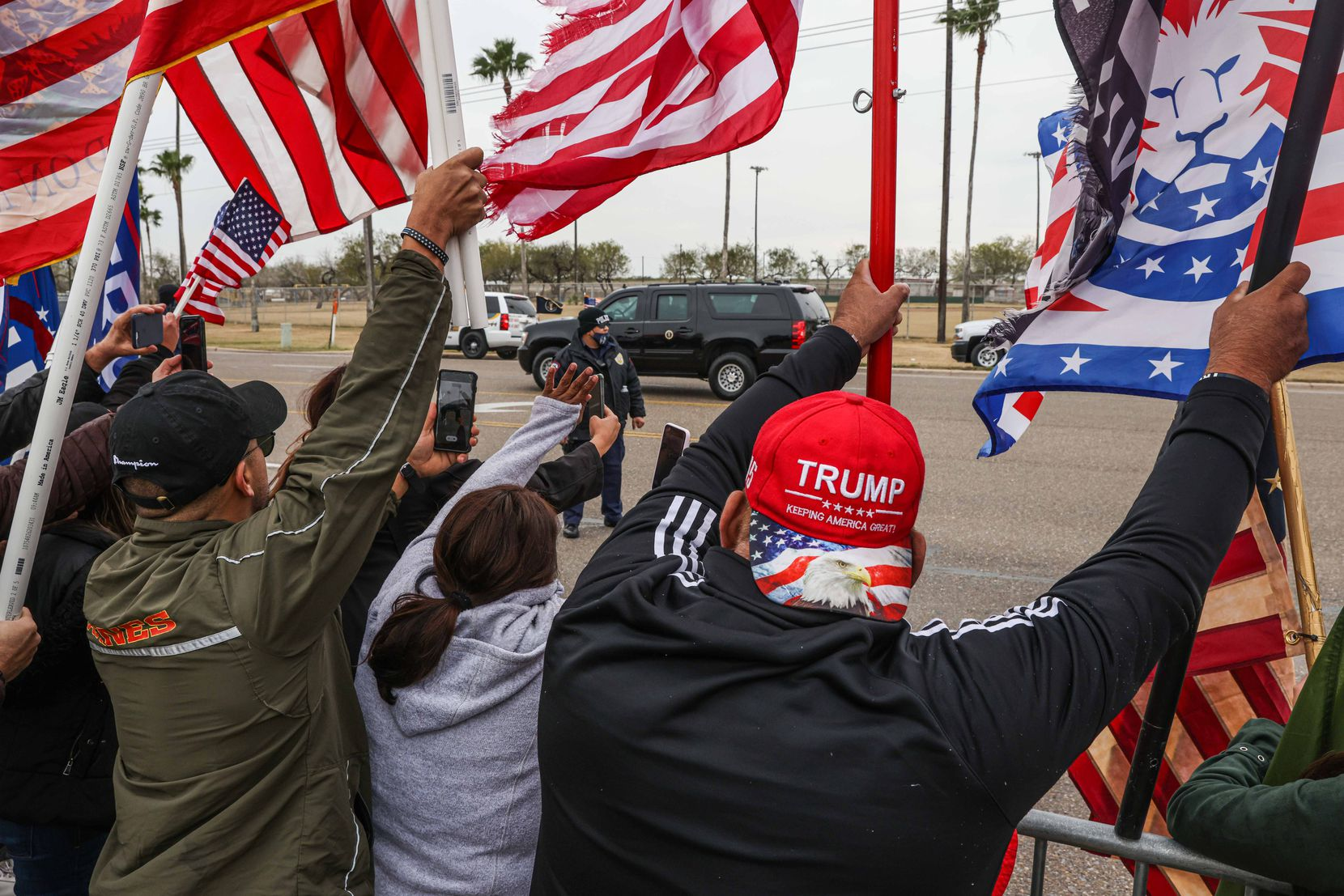 President Donald Trump motor arcade passes in front of the rally in support as he visit part of the wall built under his mandate in McAllen on Tuesday, January 12, 2021.