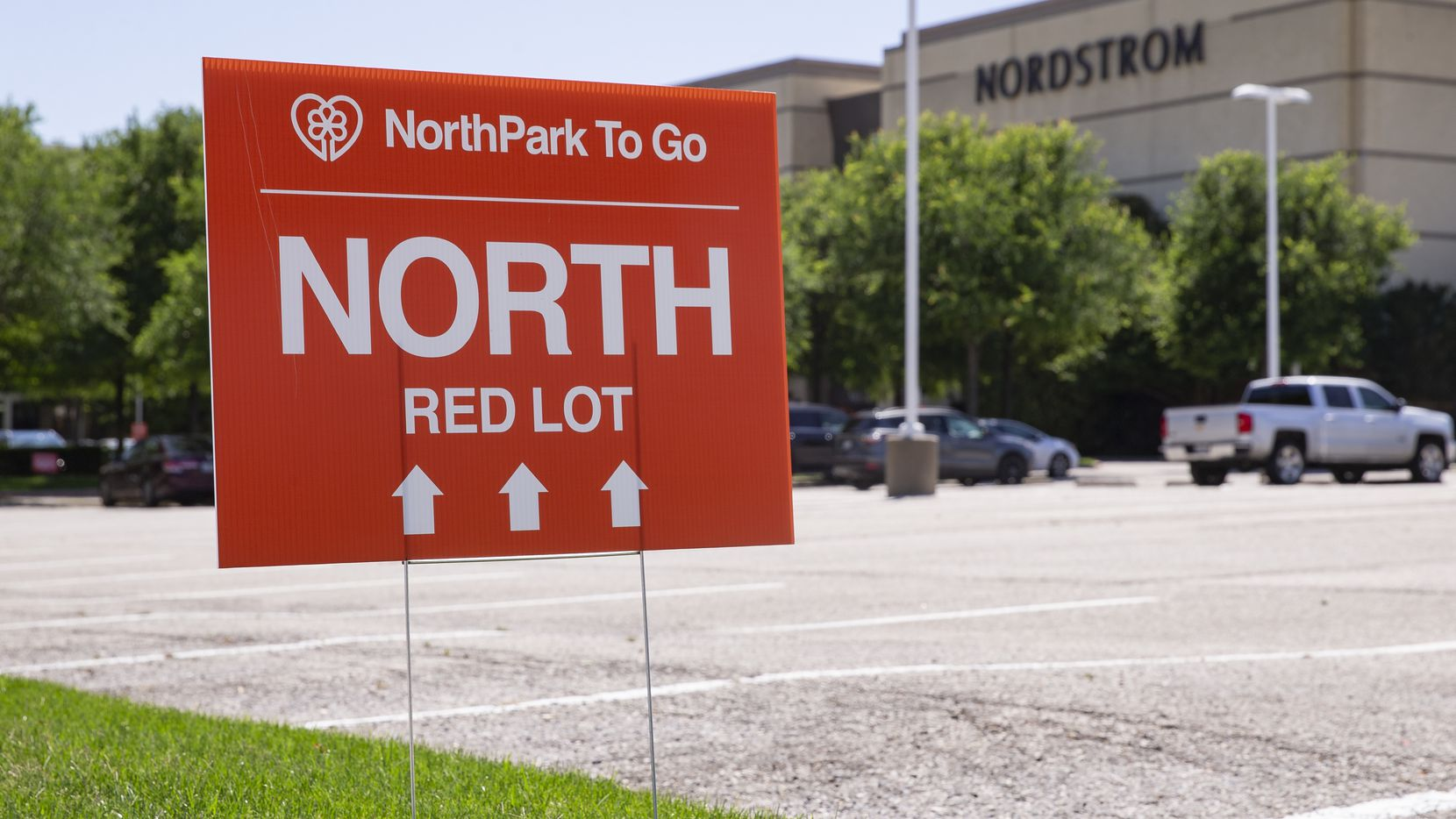 A sign at NorthPark directs customers to the Red Lot for order pickup on April 23, 2020 in Dallas. Texas Gov. Greg AbbottÕs Òretail to goÓ phase of reopening the stateÕs economy starts Friday. (Juan Figueroa/ The Dallas Morning News)