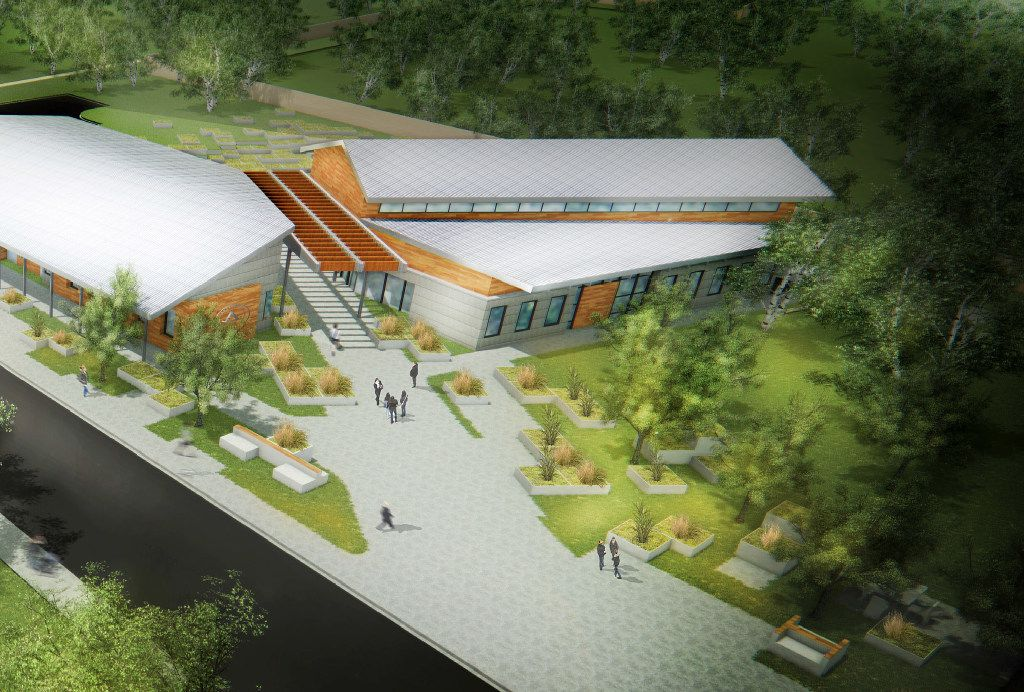 An artist rendering shows the 29 Acres community center, which is going to be about 7,000 square feet. It will house administration, vocational labs/training areas, teaching kitchen/common eating area, chill area where residents can come together and watch TV or play games, and probably a small library. Separately, homes on the property will be around 3,000 square feet and will have four bedrooms, each with private bathroom and shared living spaces, including a kitchen, living room, eating area, and laundry room. There will also be an office for staff in the home.