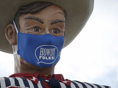 "Big Tex sports a ""Howdy, folks!"" face mask at Fair Park in Dallas on Wednesday, Sept. 16, 2020. The mask is 84 inches by 45 inches, or roughly 7 feet by 4 feet. The State Fair of Texas has been cancelled this year due to the global pandemic."