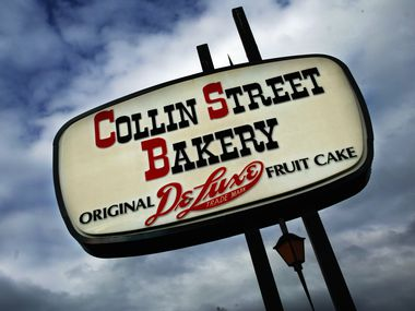 In this 2003 file photo, the sign for Collin Street Bakery stands out against the sky.