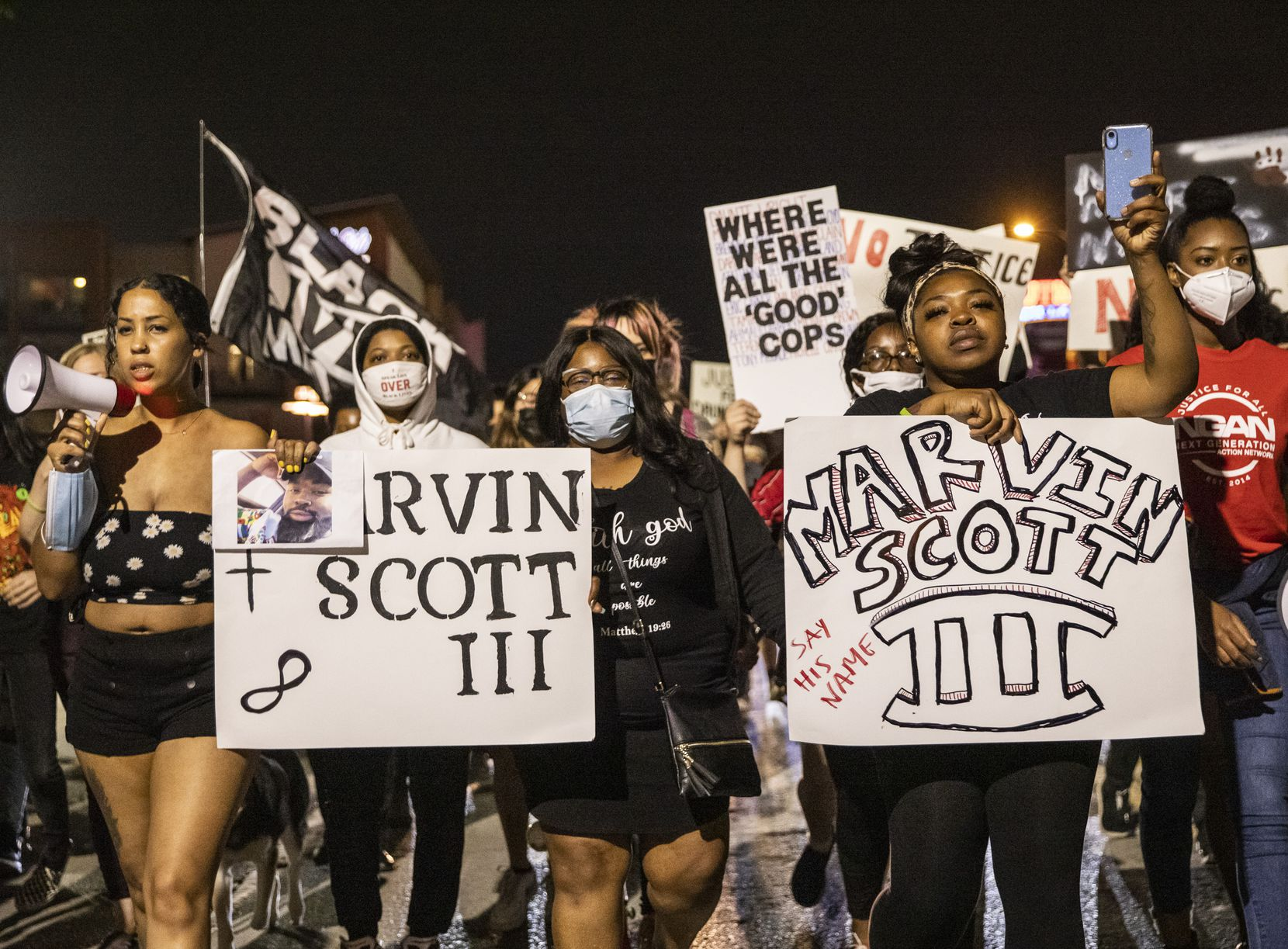 Activist Renee White (left); Marvin Scott III's mother, LaSandra Scott (center); and his sister LaChay Batts (right) participated in a protest march down Botham Jean Boulevard in Dallas in April.