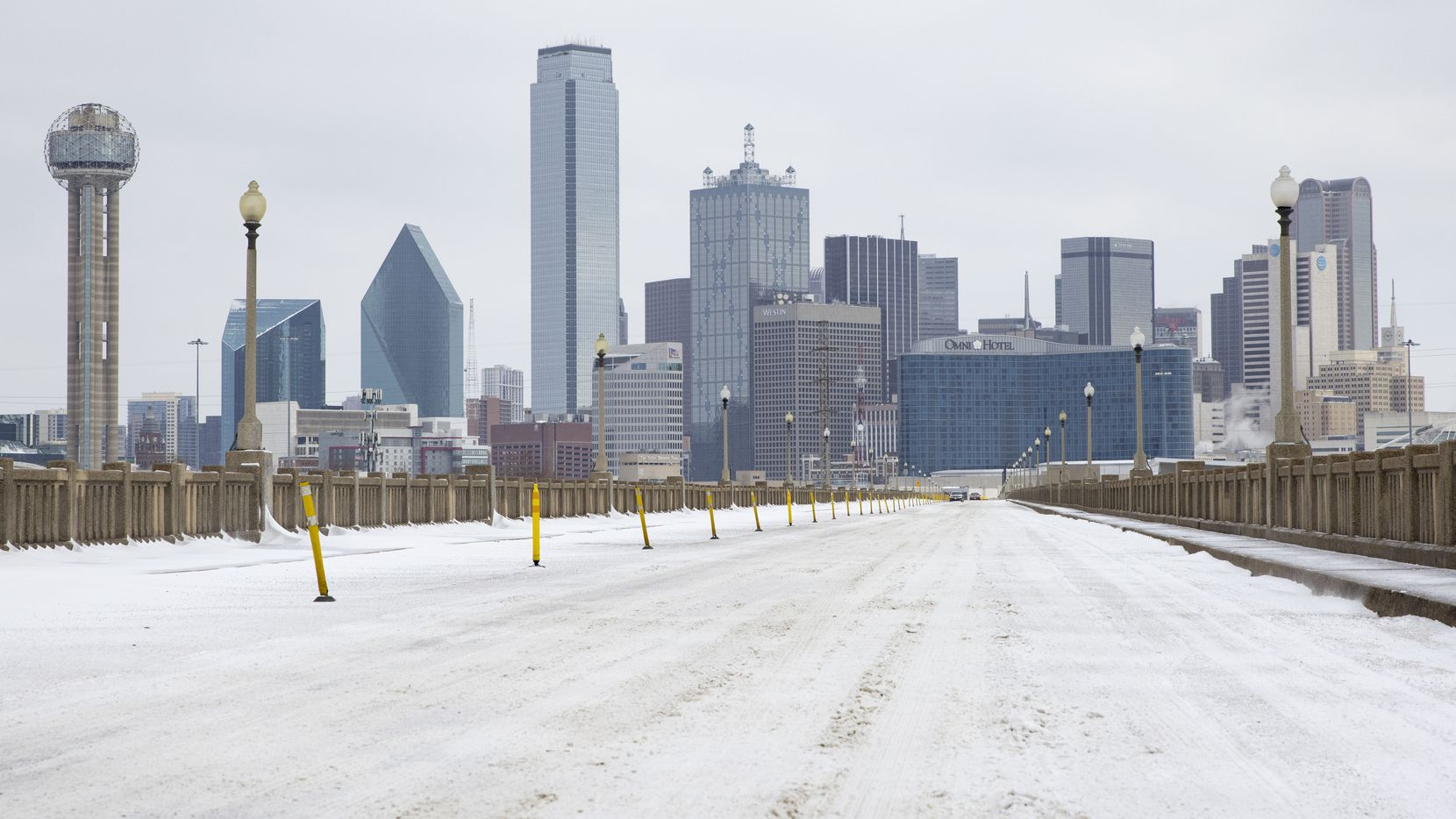 A snow-covered Downtown Dallas seen from S Houston St on Monday, Feb. 15, 2021.