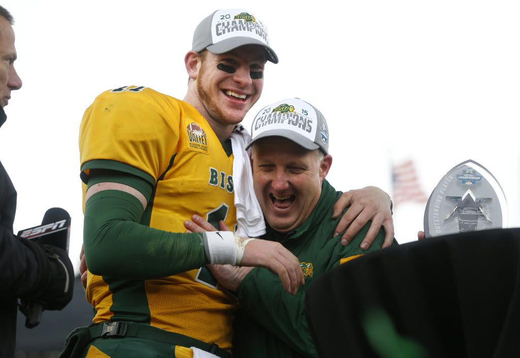 North Dakota State Bison head coach Chris Klieman (right) hugs quarterback Carson Wentz (11) after beating the Jacksonville State Gamecocks 37-10 after the FCS Championship Game at Toyota Stadium in Frisco, Texas January 9, 2016. (Nathan Hunsinger/The Dallas Morning News)