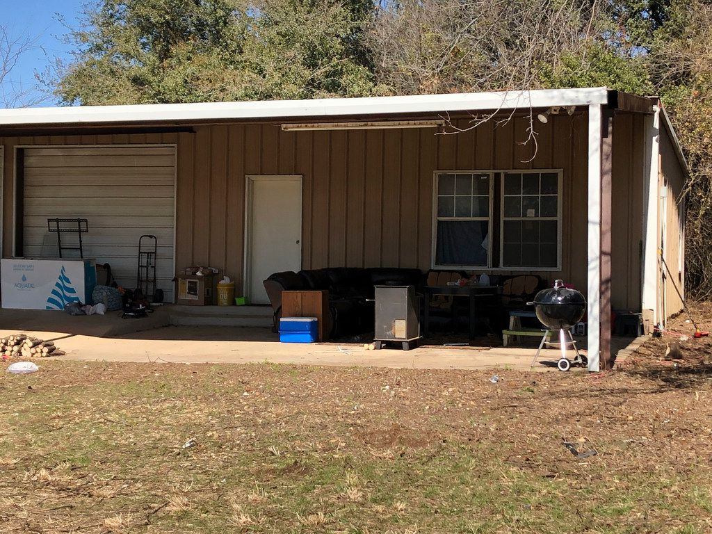 A photo shows the home where officials say Wise County sheriff's deputies found four malnourished children under the age of 5, including two locked in a dog kennel. Their mother, Paige Harkings, and a man identified as the father of one of the children, Andrew Fabila, were arrested. Each faces four counts of endangering a child.
