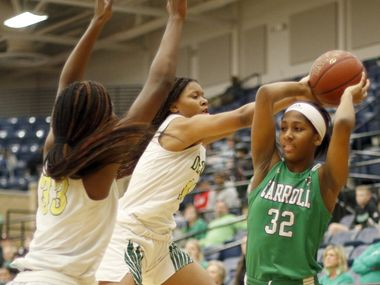 Southlake Carroll's Jillian Sowell (32) looks to pass as she faces the aggressive defense of DeSoto's Amina Muhammad (left) and Jiya Perry during DeSoto's 65-33 win in Friday's Class 6A area-round playoff game at Mansfield Legacy High School. (Steve Hamm/Special Contributor).