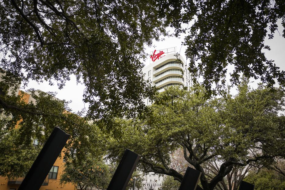 Virgin Hotels Dallas rises over a tree-lined esplanade on Monday, Dec. 16, 2019, in Dallas. The hotel is at 1445 Turtle Creek Blvd. in the Dallas Design District.