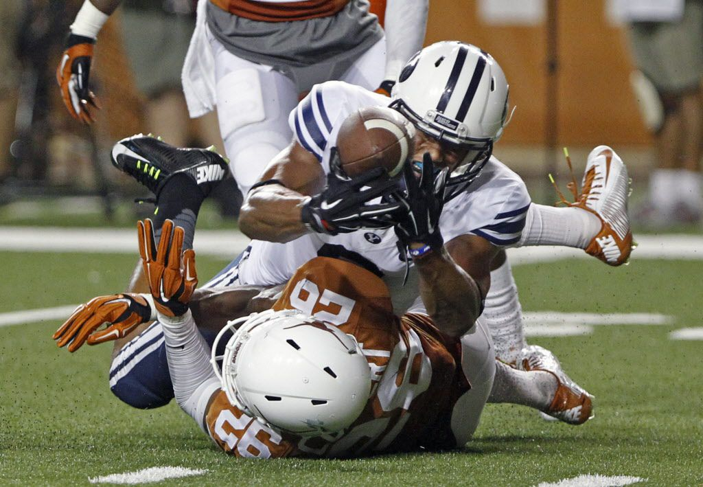 BYU receiver Jordan Leslie (9) catches a pass over Texas' Antwuan Davis (26) during the third quarter of an NCAA college football game against the Longhorns in Austin, Texas, on Saturday,  Sept. 6, 2014.  (AP Photo/Michael Thomas)