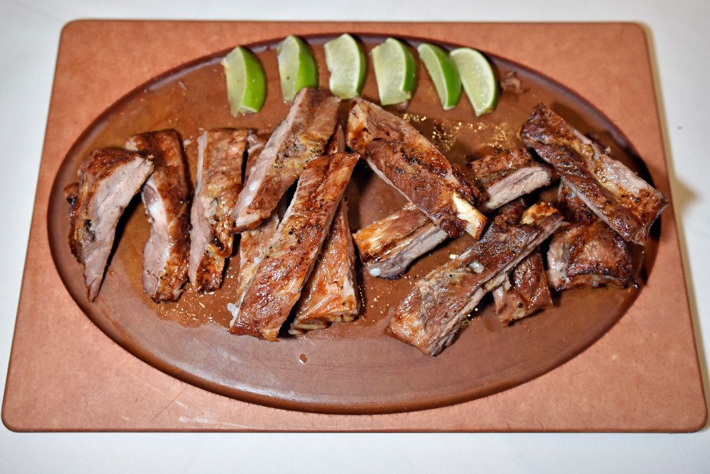 Pork ribs sliced and served at the new Fogo de Ch‹o in Uptown, Friday, May 19, 2017 in Dallas. Ben Torres/Special Contributor