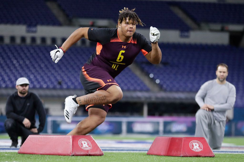 UCF defensive lineman Trysten Hill runs a drill at the NFL football scouting combine in Indianapolis, Sunday, March 3, 2019. (AP Photo/Michael Conroy)