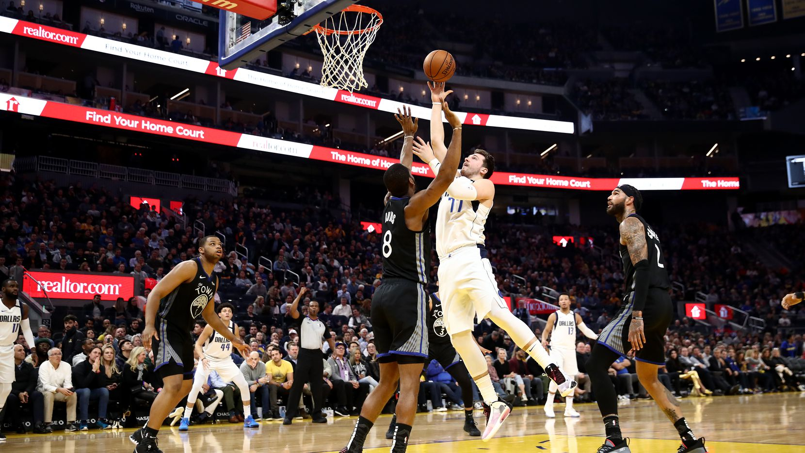 SAN FRANCISCO, CALIFORNIA - JANUARY 14:  Luka Doncic #77 of the Dallas Mavericks goes up for a shot on Alec Burks #8 of the Golden State Warriors at Chase Center on January 14, 2020 in San Francisco, California.