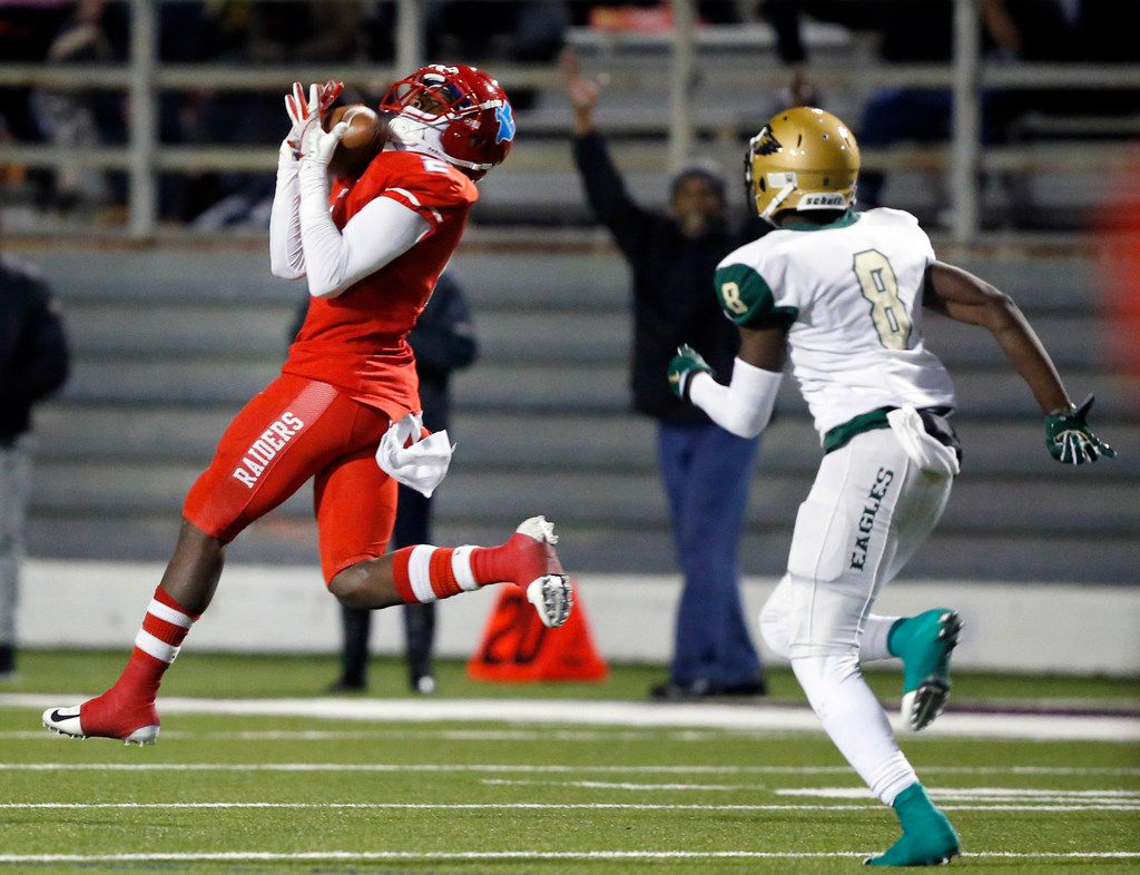 Skyline wide receiver Quaydarius Davis (2) catches a long second quarter touchdown pass against DeSoto defensive back Paul Pickens (8) during their Class 6A Division I football playoff game at Forester Field in Dallas, Friday, November 16, 2018. (Tom Fox/The Dallas Morning News)