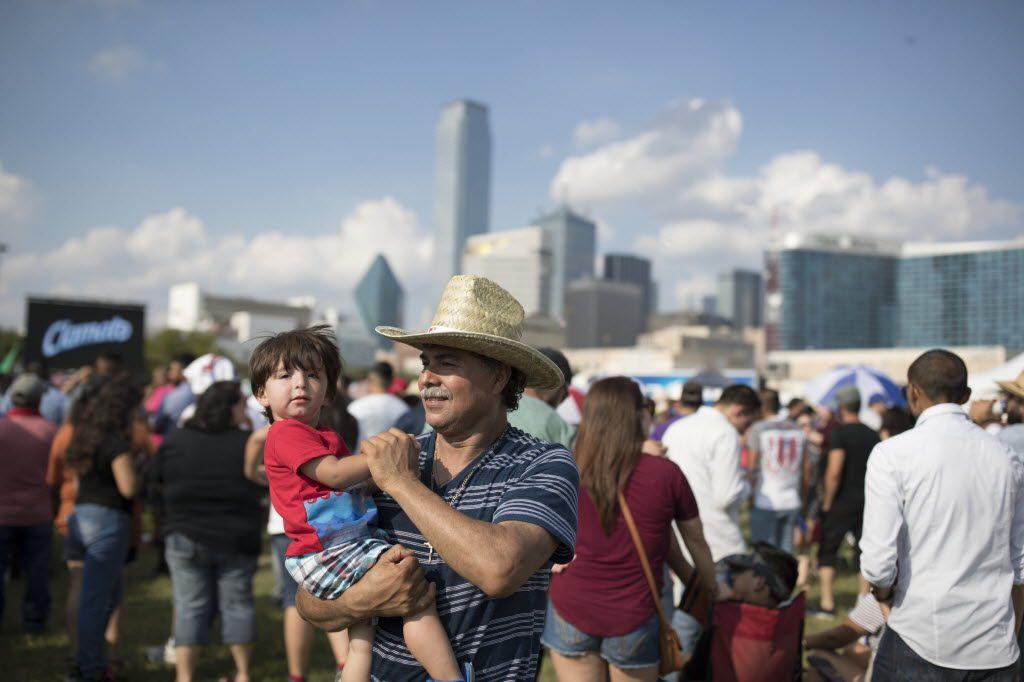 Mario Cervantes, of Plano, Texas dances with his grandson, Mario Matel, 1, during La Grande 107.5 Fiestas Patrias at Reunion Park on Sept. 4, 2016 in Dallas.