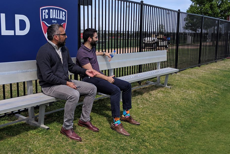 Director of Soccer Operations Marco Ferruzzi (left) and Team Administrator Juan Gonzalez watch FC Dallas training. (4-10-19)
