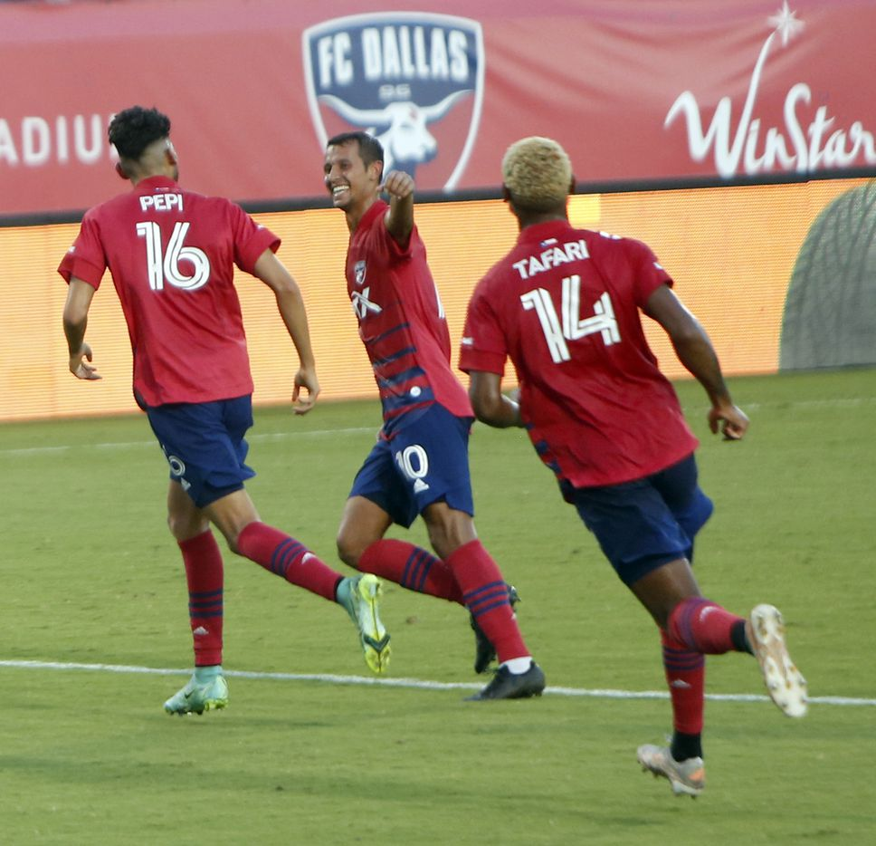 FC Dallas forward Ricardo Pepi (16) is congratulated by teammates Andres Ricuarte (10 and Nikosi Tafari (14) after his second goal during the first half against LA Galaxy. Pepi scored 3 goals enroute to FC Dallas' 4-0 victory. The two teams played their MLS match at Toyota Stadium in Frisco on July 24, 2021. (Steve Hamm/ Special Contributor)