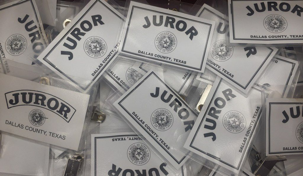 Juror badges sit on the counter in the Central Jury Room of the George Allen Courts Building in Dallas, Texas on Nov. 27, 2018.